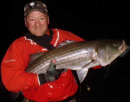"Benjamin Redmond from Maine caught this 42"" BEAST of a Striped Bass on a Sea Habit - Herring while fly fishing offshore of Scarborough, Maine after midnight. Now that is passion for the sport!"