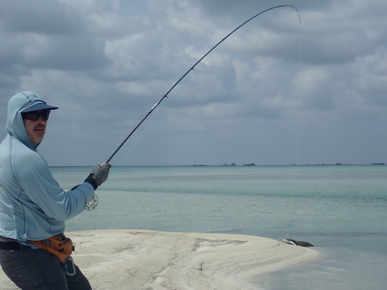 Tim Hennessey reeling in a bonefish and an alligator!